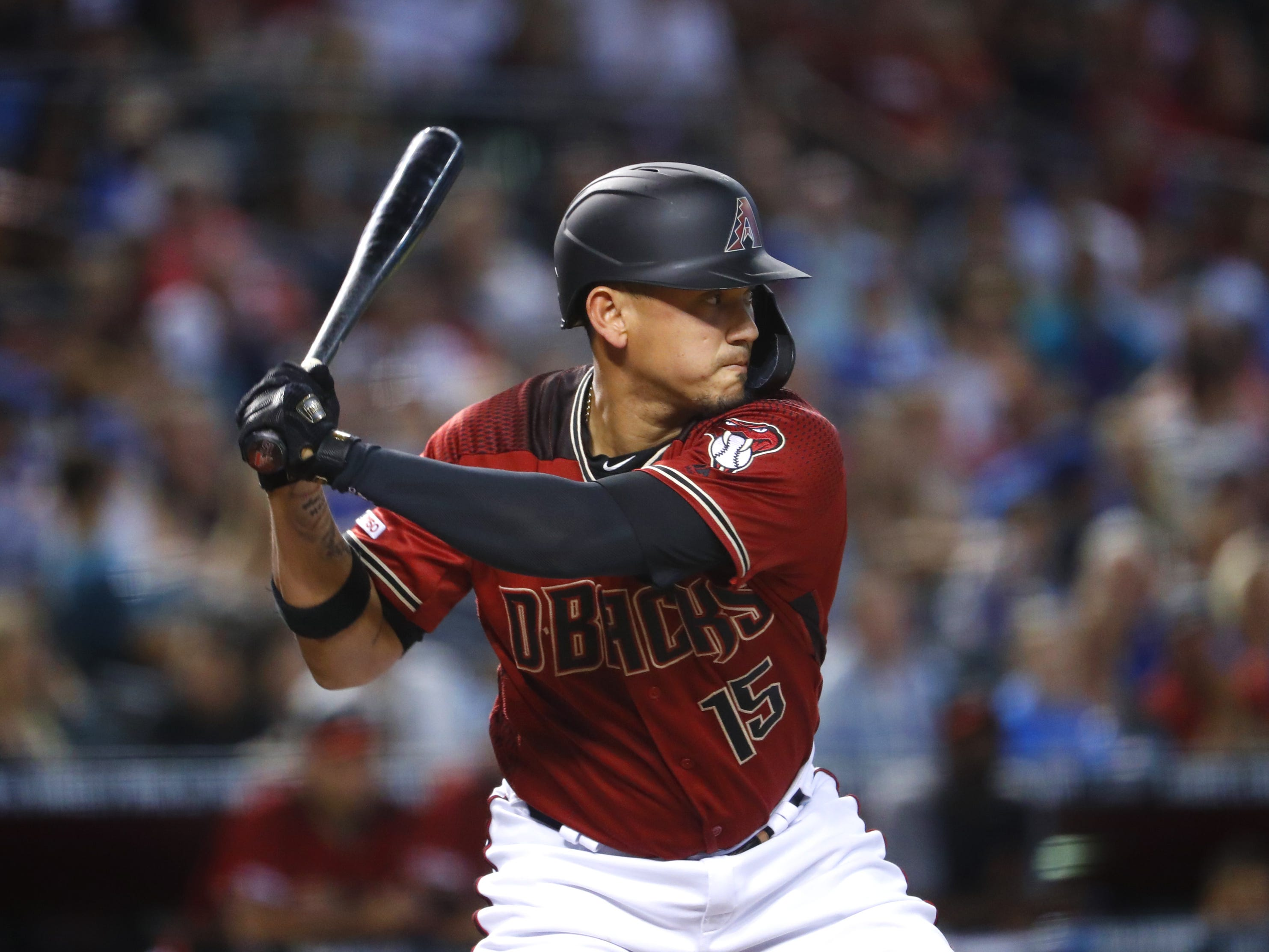 Diamondbacks' Ildemaro Vargas (15) swings at a pitch against the Cubs during the sixth inning at Chase Field in Phoenix, Ariz. on April 28, 2019.