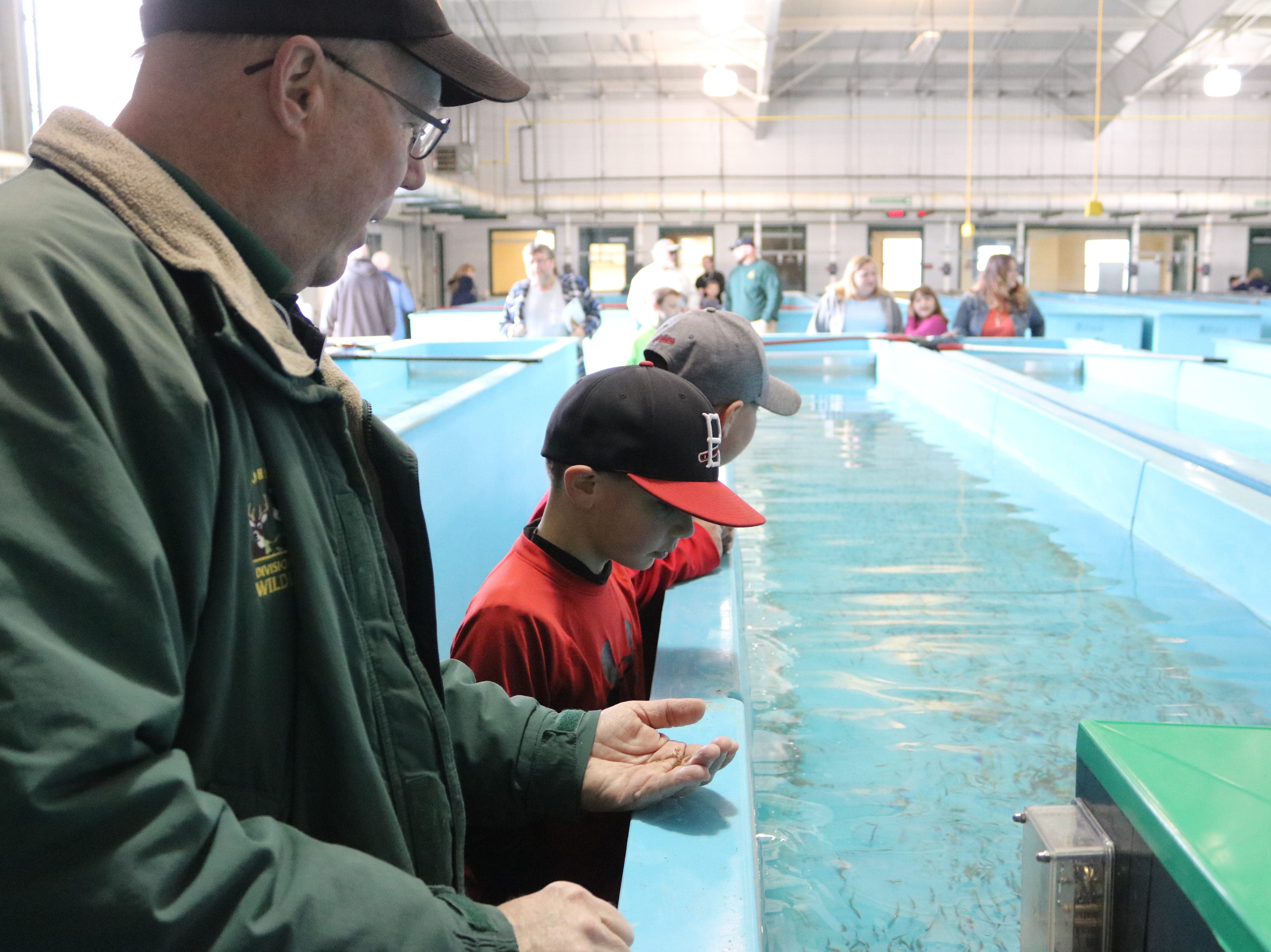 Kevin Kayle, administrator of the state fish hatchery program, speaks with the children during the open house in Castalia on Saturday.