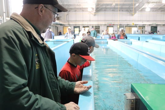 Kevin Kayle, administrator of the state fish hatchery program, speaks with the children during the open house in Castalia.