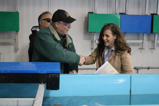 Kevin Kayle, administrator of the state fish hatchery program, speaks with State Sen. Theresa Gavarone during the open house in Castalia.