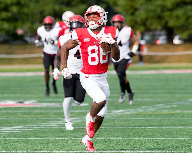 Juston Christian runs with the football. The Marist College wide receiver signed a pro contract with the Baltimore Ravens last week.
