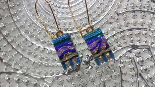"""Carnival Blues,"" dichroic glass earrings by RoseAnna Stokes, are featured at Dutchess Handmade this spring."