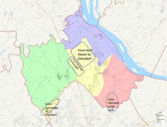 Northeastern School District presented an early proposal for redrawing its elementary school boundaries at an April 23 town hall. This map from the April presentation shows dots that represent students within each of the four elementary school lines. Dots that differ in color from the circled areas represent students who would be moving to or registering at a new school.