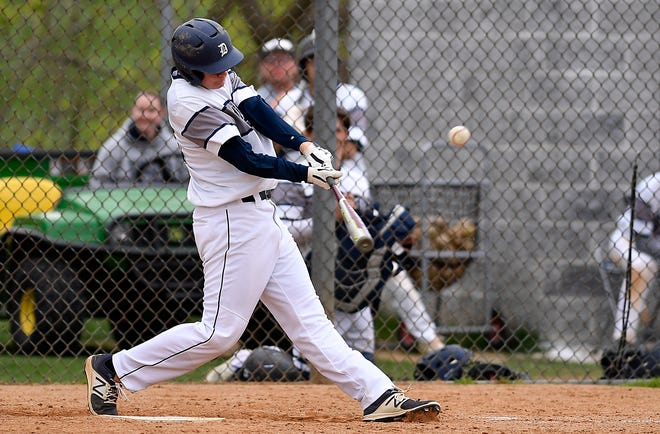 Dallastown's Evan Beach connects with the game-winning RBI single in the 8th inning against Red Lion, Monday, April 29, 2019.John A. Pavoncello photo