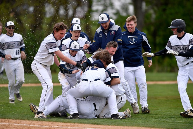 Dallastown players celebrate after a pivotal York-Adams Division I victory over rival Red Lion on Monday, April 29. The Wildcats hope to celebrate again when the Y-A League playoffs conclude next Tuesday.