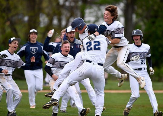 Dallastown celebrates after defeating Red Lion 2-1 in the 8th inning, Monday, April 29, 2019.