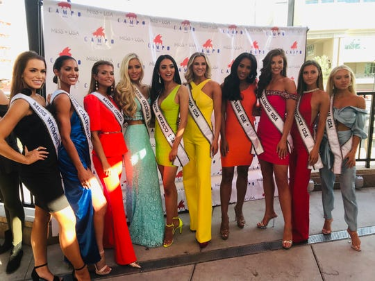 A rainbow of Miss USA contestants on the terrace of Campo restaurant in downtown Reno, Nev., on April 28, 2019. The 2019 pageant is in Reno on May 2.