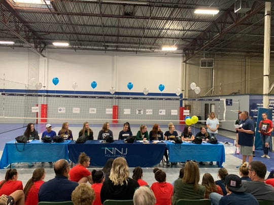 Several high school volleyball players signed for college last week.