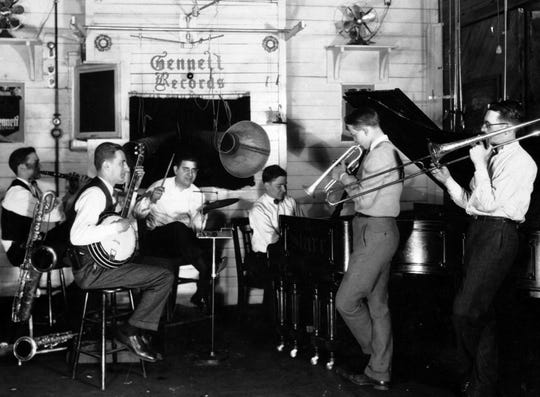 Bix's Rhythm Jugglers at Gennett Recording Studio in Richmond, Indiana, 1925. Band, from left: Don Murray (clarinet), Howdy Quicksell (banjo), Tommy Gargano (drums), Paul Mertz (piano), Bix (cornet), Tommy Dorsey (trombone).  Bix, a Davenport native, was a self-taught player and one of the most influential jazz musicians in the 1920s leading up to his untimely death in 1931.