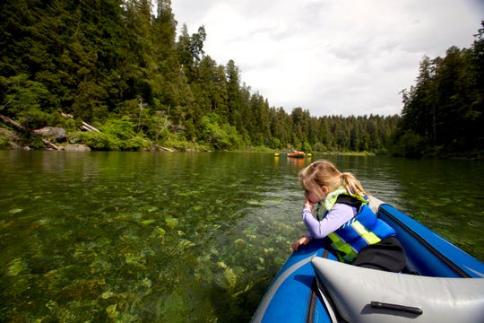 """Lucy Urness, 3, looks out at the Smith River while doing the """"redwoods float""""  at Jedediah Smith Redwoods State Park, just south of the Oregon and California state line."""