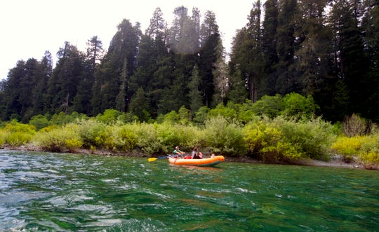 "In a raft on the ""redwoods float"" down the Smith River at Jedediah Smith Redwoods State Park, just south of the Oregon and California state line."