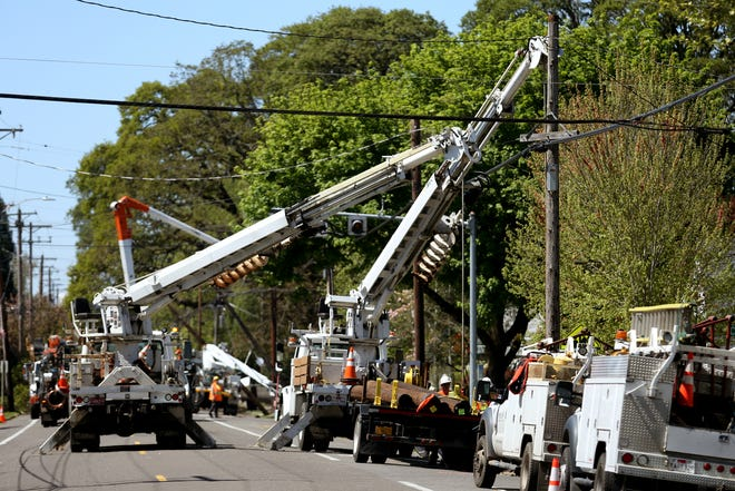 Center St. NE is closed from 20th to 24th St. NE as crews work to restore power after a downed tree knocked over power lines in Salem on April 29, 2019.