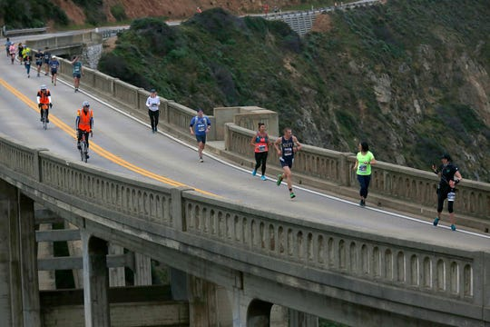 Jordan Tropf of Silver Springs, MD runs across Bixby Bridge on his way to a win during the Big Sur Marathon in Big Sur, CA on Sunday April 28, 2019. (Photo by David Royal)