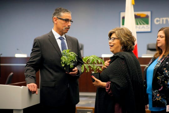 City Councilwoman Gloria De La Rosa chats with Pablo Barreto, the new chief of the Salinas Fire Department, after a press conference on Barreto's appointment April 29, 2019. City Councilman Steve McShane (not pictured) handed out free tomato plants as part of the welcome for Barreto.
