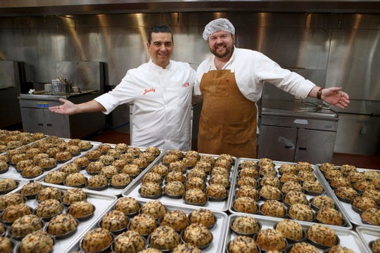 Host Buddy Valastro poses with baker Blake Jackson and his mass-produced dish following round three, as seen on Bake You Rich, Season 1.