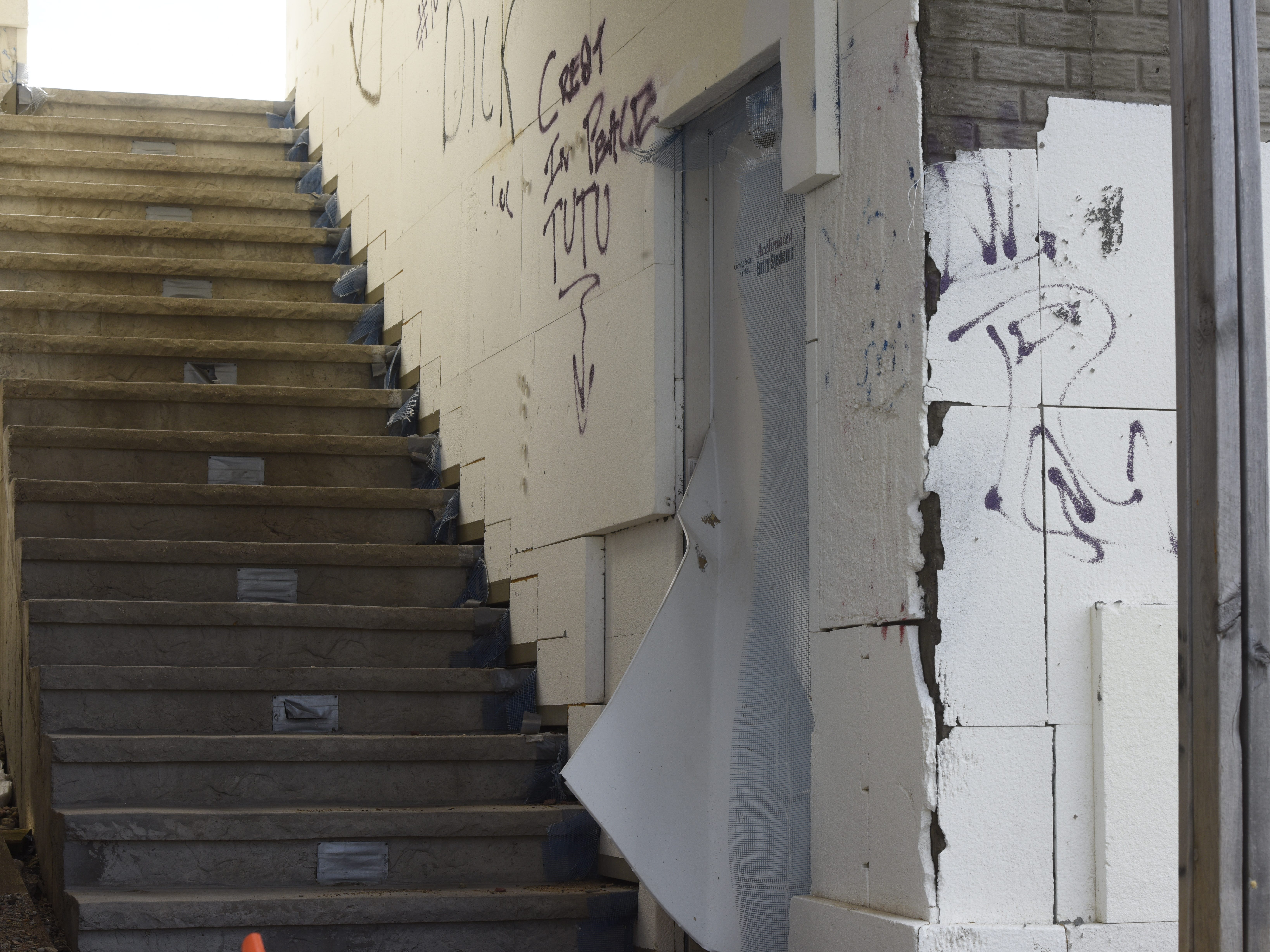 The city of Sioux Falls is suing the owner of property at 6800 S Westfield Trail in hopes of ceasing and demolishing the unfinished structure on it. Graffiti, unkempt weeds and construction debris that litter the property have generated multiple code violation citations since work on the project started in 2013.