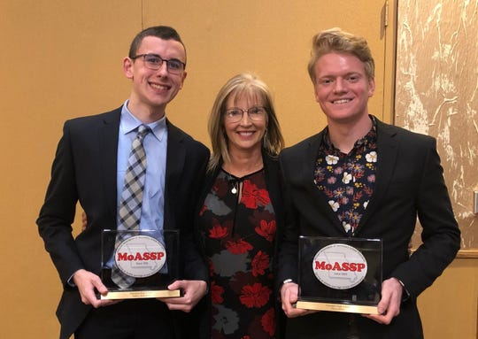Glendale High School seniors Andrew Robertson, left, and Ethan Miller pose with principal Natalie Cauldwell at the top 100 event sponsored by the Missouri Association of Secondary School Principals.