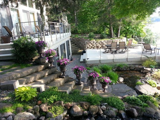 The extensively landscaped yard is breathtaking with its blue slate stepping stone staircase, four-level waterfall and 1,100-gallon koi pond, and gardens of flowering shrubs, perennials and hostas.