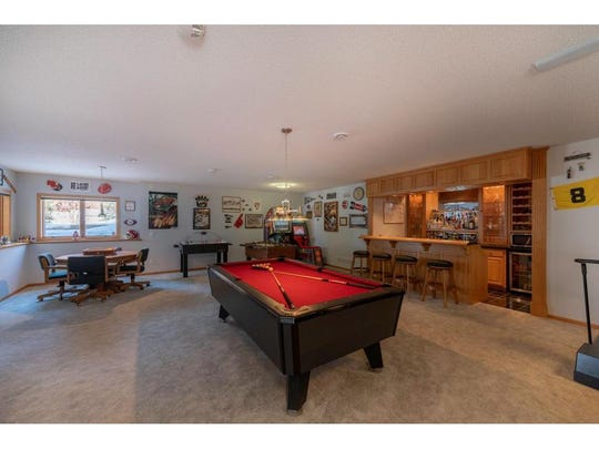 The lower-level family room has another fireplace and ample space for a pool table, game area and a dedicated movie space.