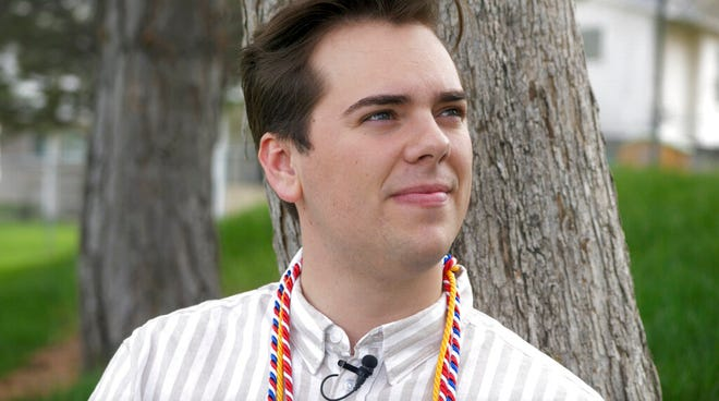 Matt Easton poses for a photograph as he sits in a park Monday, April 29, 2019, in Cottonwood Heights , Utah. Easton, A gay student who came out during a valedictorian speech at Mormon-owned Brigham Young University is earning applause and admiration from fellow students and figures like actress Kristin Chenoweth and the husband of gay Democratic presidential candidate Pete Buttigieg. (AP Photo/Rick Bowmer)