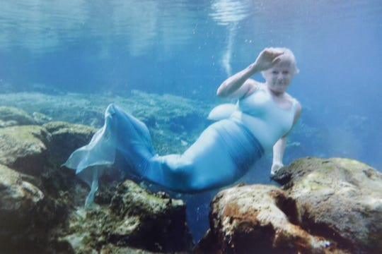 Jo Ostrov, a woman who always wanted to be a mermaid at Weeki Watchi Springs State Park, swims in the springs as a mermaid.