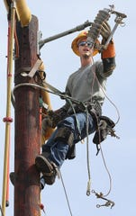 File art of a city of Tallahassee lineman demonstrating an electric repair.