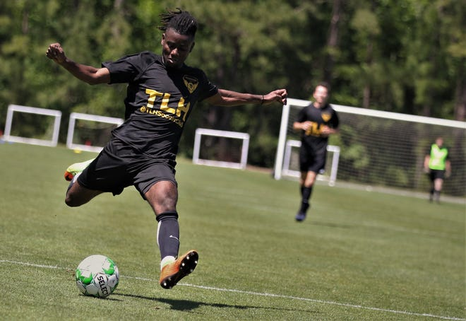 Tallahassee Soccer Club forward Boneco Bazil takes a shot on goal as TLHSC played Thomas University to a 1-1 tie during a scrimmage in Thomasville on Saturday, April 27, 2019.