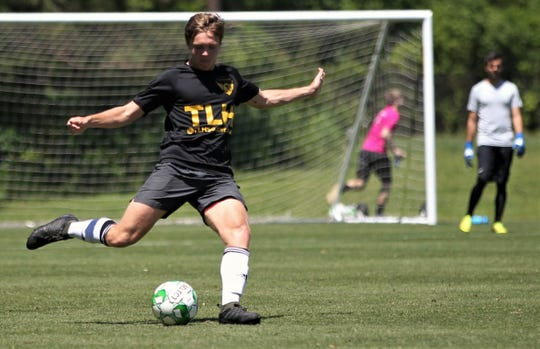 Tallahassee Soccer Club defender Mark-Ryan Lescher, a former Leon High player, sends a ball upfield as TLHSC played Thomas University to a 1-1 tie during a scrimmage in Thomasville on Saturday, April 27, 2019.