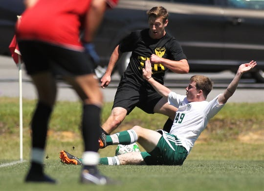 Tallahassee Soccer Club forward Ian Hildebrandt, a former Chiles High player, tries to retain possession during a slide tackle as TLHSC played Thomas University to a 1-1 tie during a scrimmage in Thomasville on Saturday, April 27, 2019.