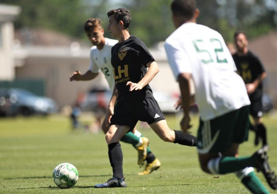 Tallahassee Soccer Club midfielder Ian Ward, a former Lincoln High player, dribbles as TLHSC played Thomas University to a 1-1 tie during a scrimmage in Thomasville on Saturday, April 27, 2019.
