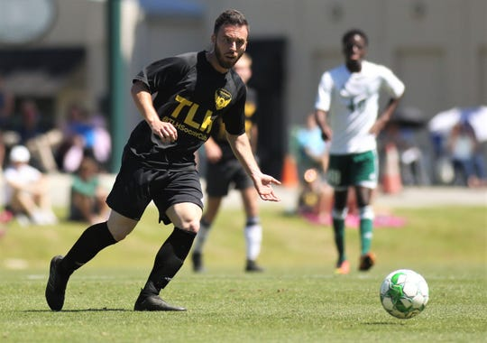Tallahassee Soccer Club midfielder Luke Pelkowski plays a ball as TLHSC played Thomas University to a 1-1 tie during a scrimmage in Thomasville on Saturday, April 27, 2019.