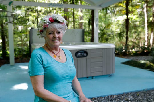 Jo Ostrov, a woman who always wanted to be a mermaid at Weeki Watchi Springs State Park, in her backyard which she turned into a mermaid lagoon Friday, April 26, 2019.
