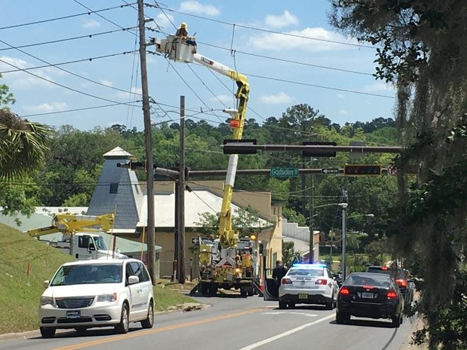 City Electric Utility crews make repairs after a construction incident at Calhoun and Gaines streets that knocked out power to some 1,400 customers.