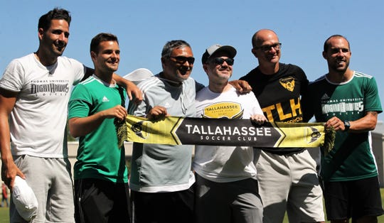 Tallahassee Soccer Club president Chris Petley (hat and sunglasses) stands with his coaches and Thomas University coaches after TLHSC played Thomas University to a 1-1 tie during a scrimmage in Thomasville on Saturday, April 27, 2019.
