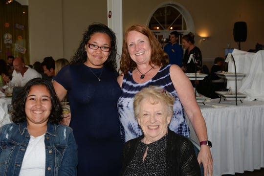 """Representing four generations, Hailey Chandler, left, Elizabeth Chandler, Diane Felter and Helen Felter at Treasure Coast Hospice's """"Time for Tea, A Journey through the Decades"""" fundraiser at Pelican Yacht Club."""