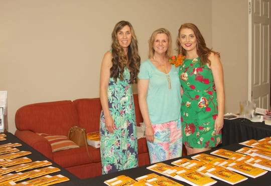 Laura Barnes, left, Dana Trabulsy and Lindsey Concannon welcome guests to the 29th annual Port St. Lucie Business Women's Fashion Show.