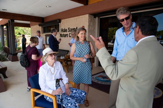 """Family members of local environmentalist Nathaniel P. Reed, (from left) wife Alita Reed, daughter-in-law Michelle Reed and son Adrian Reed, attend a news conference Monday, April 29, 2019, at the Nathaniel P. Reed Hobe Sound National Wildlife Refuge in Hobe Sound. """"If we allow selfish people to spoil our rivers, ponds and ocean, the critters will suffer, but so will we,"""" Reed said before introducing Gov. Ron DeSantis to the podium. """"People created this problem and people are the solution. People like my father with courage in their hearts and fire in their bellies ... people like Gov. Ron DeSantis, who are every day proving that we are in a new era, an era of hope for clean air, clean water, and a beautiful future for Florida's children."""""""