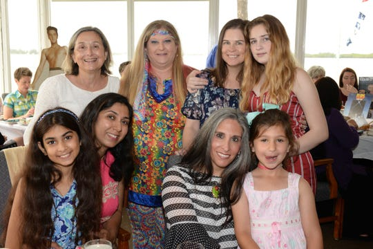 """Stephanie Hubbard, standing, from left, Staci Dunn, Brook Barn and Sage Sparks, with, seated, Aria Kaul, Resham Khilnani, and Christina and Arianna Smits at Treasure Coast Hospice's """"Time for Tea, A Journey through the Decades"""" fundraiser at Pelican Yacht Club."""