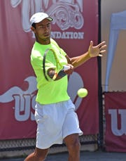 Former LSU standout Boris Arias, a member of Bolivia's Davis Cup team, won his qualifying match Monday.