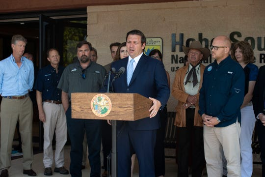 "Gov. Ron DeSantis and Secretary of the Florida Department of Environmental Protection Noah Valenstein announce a Blue-Green Algae Task Force during a news conference Monday, April 29, 2019, at the Nathaniel P. Reed Hobe Sound National Wildlife Refuge in Hobe Sound. The team will consist of leaders at Florida universities and marine organizations, including Evelyn Gaiser, Wendy Graham, Valerie J. Paul, Mike Parks and James Sullivan. ""The focus of this task force is to support key funding and restoration initiatives and make recommendations to expedite nutrient reductions in Lake Okeechobee and downstream estuaries,"" DeSantis said."