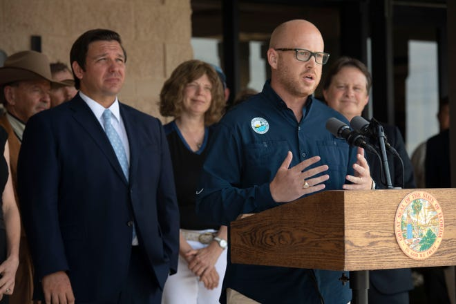 """Gov. Ron DeSantis and Secretary of the Florida Department of Environmental Protection Noah Valenstein announce a Blue-Green Algae Task Force during a news conference Monday, April 29, 2019, at the Nathaniel P. Reed Hobe Sound National Wildlife Refuge in Hobe Sound. The team will consist of leaders at Florida universities and marine organizations, including Evelyn Gaiser, Wendy Graham, Valerie J. Paul, Mike Parks and James Sullivan. """"The focus of this task force is to support key funding and restoration initiatives and make recommendations to expedite nutrient reductions in Lake Okeechobee and downstream estuaries,"""" DeSantis said."""
