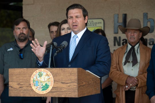 Gov. Ron DeSantis announces members of a Blue-Green Algae Task Force during a news conference Monday, April 29, 2019, at the Nathaniel P. Reed Hobe Sound National Wildlife Refuge in Hobe Sound.