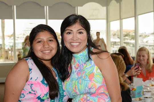 "Jennifer Barajas, left, and Olga Medina at Treasure Coast Hospice's ""Time for Tea, A Journey through the Decades"" fundraiser at Pelican Yacht Club."