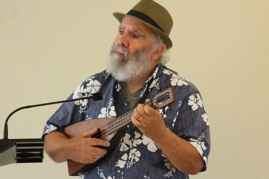 Bruce Lippman with the Treasure Coast Ukulele Club performs at the St. Lucie County Library's annual Volunteer Luncheon