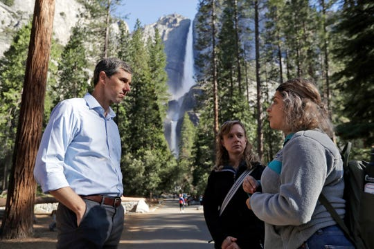 Democratic presidential candidate and former Texas congressman Beto O'Rourke, left, talks with Anne Kelly, center, Director of the Sierra Nevada Research Stations and environmental advocate Leslie Martinez center, Monday, April 29, 2019, in Yosemite National Park, Calif. (AP Photo/Marcio Jose Sanchez)