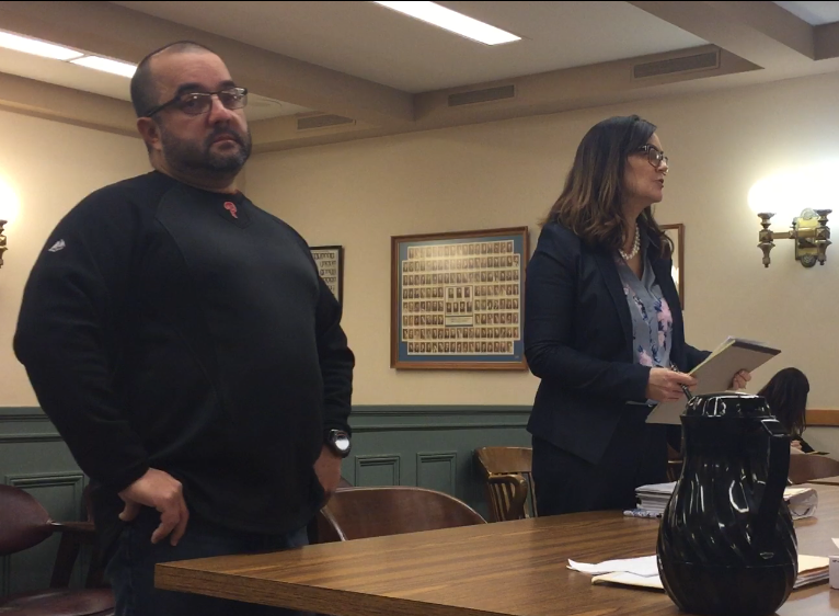 Luis A. Santiago (left), a suspended Bridgeton police sergeant, is facing trial on charges on sexual harassment charges. Santiago was in Cumberland County Superior Court on Monday for a pre-trial hearing. Here, defense attorney Diane Ruberton, addresses Judge Michael Silvanio on an evidence issue.