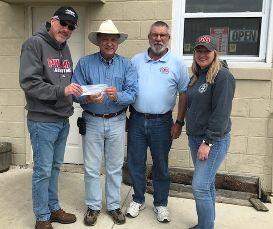 The South Jersey Cruisers Association Car Club recently held its Brews and Cruise Car Cruise at the Glasstown Brewery in Millville. The Millville Army Air Field Museum was the beneficiary of donations from participants and from Glasstown Brewery. A check representing the donations was presented at the conclusion of the event. (From left) Robert Trivellini, accepts the donation from Ben Notaro, spokesman, South Jersey Cruisers Association Car Club, Bill VonSuskill cruise coordinator, and Jennifer Sammons; co-owner, Glasstown Brewery.