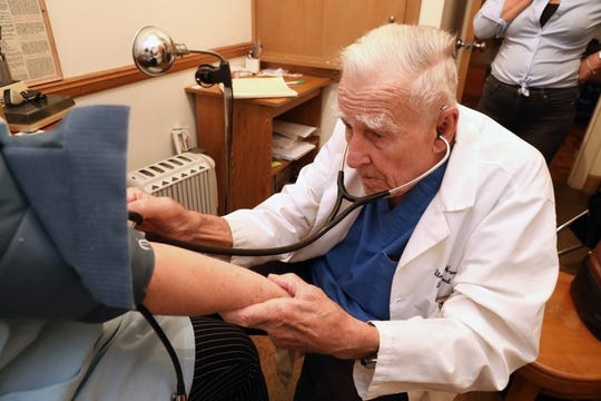 Dr. Lloyd Hamilton, 91, founder of Health Lifeline, a free clinic in Nyack for uninsured adults, checks a patient's blood pressure April 29, 2019. The health clinic has recently had funding issues and is looking for donations.