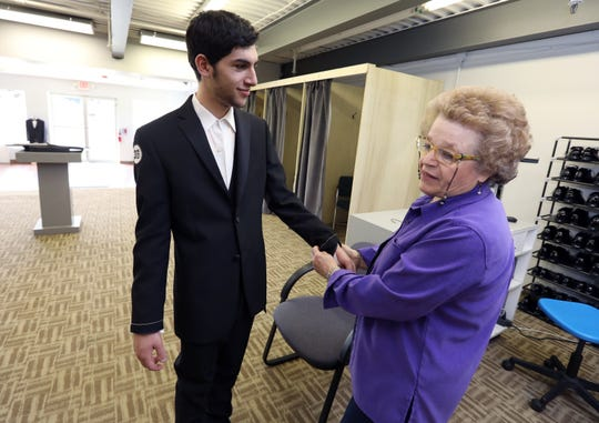 Beverly Fishman fits Noah Manea of Bardonia for a prom tuxedo at the new Michael's Tuxedos location in Nanuet April 29, 2019.