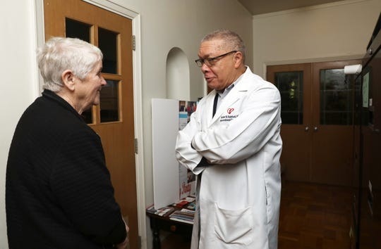 Sister Agatha Cullen of Marydell convent chats with fellow volunteer Dr. Norbert Rainford at Health Lifeline, a free clinic in Nyack for uninsured adults, April 29, 2019. The health clinic has recently had funding issues and is looking for donations.